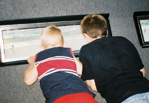 Boys looking out Arch Window.jpg